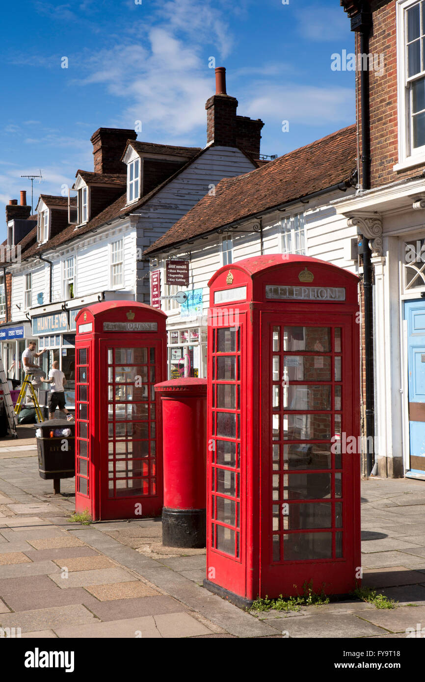 UK, Kent, Tenterden, Ashford Road, K6 phone boxes outside local shops - Stock Image