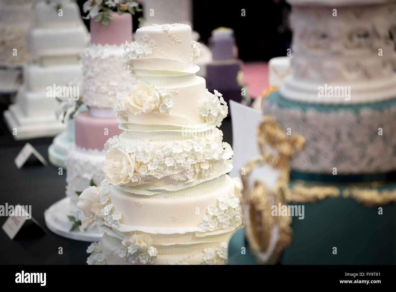 Decorative wedding cakes with edible flowers at Cake International ...