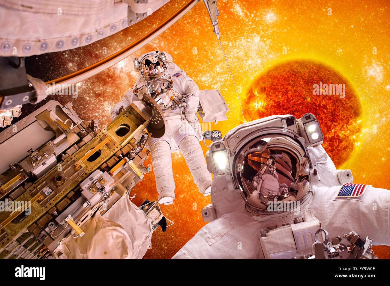 Spacecraft and astronauts in space on background sun star. Elements of this image furnished by NASA. - Stock Image