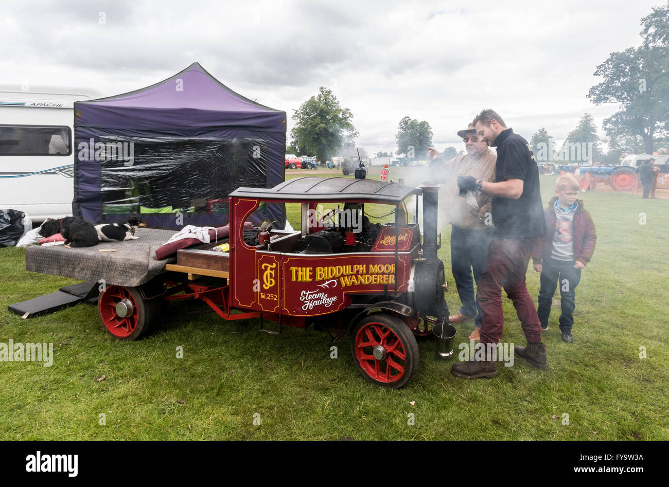 Minature steam engine being prepared at Astle Park Chelford UK - Stock Image