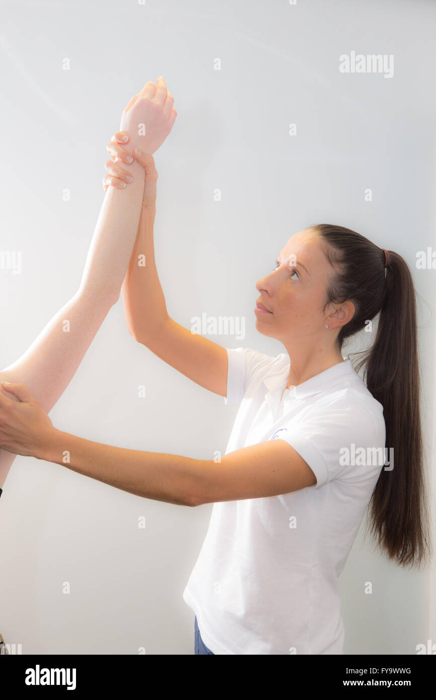 Woman receiving physiotherapy and massage - Stock Image