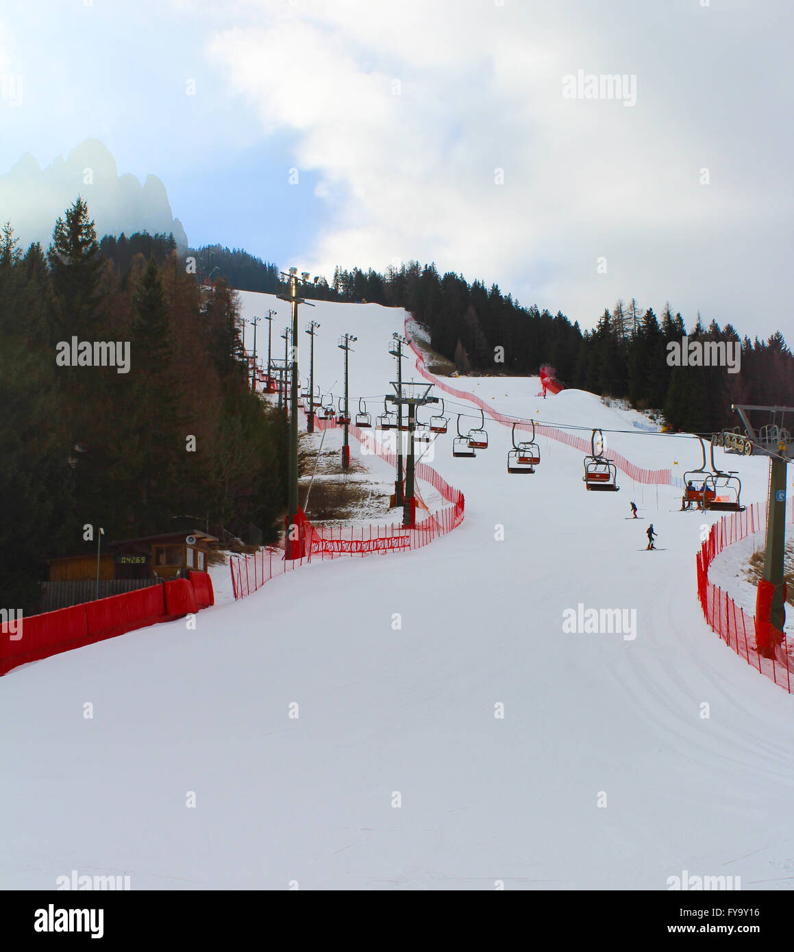 Skiers tackle a downhill run in the mountain town of Pozza Di Fassa, Trentino, Italy - Stock Image
