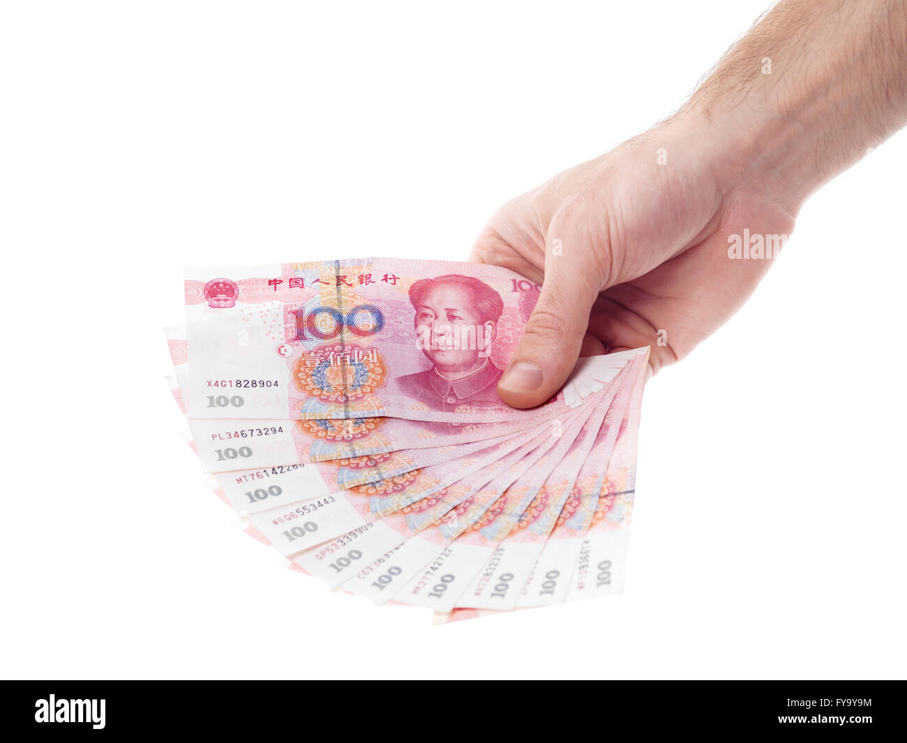 Male hand holding Renminbi bills, official currency of the People's Republic of China - Stock Image