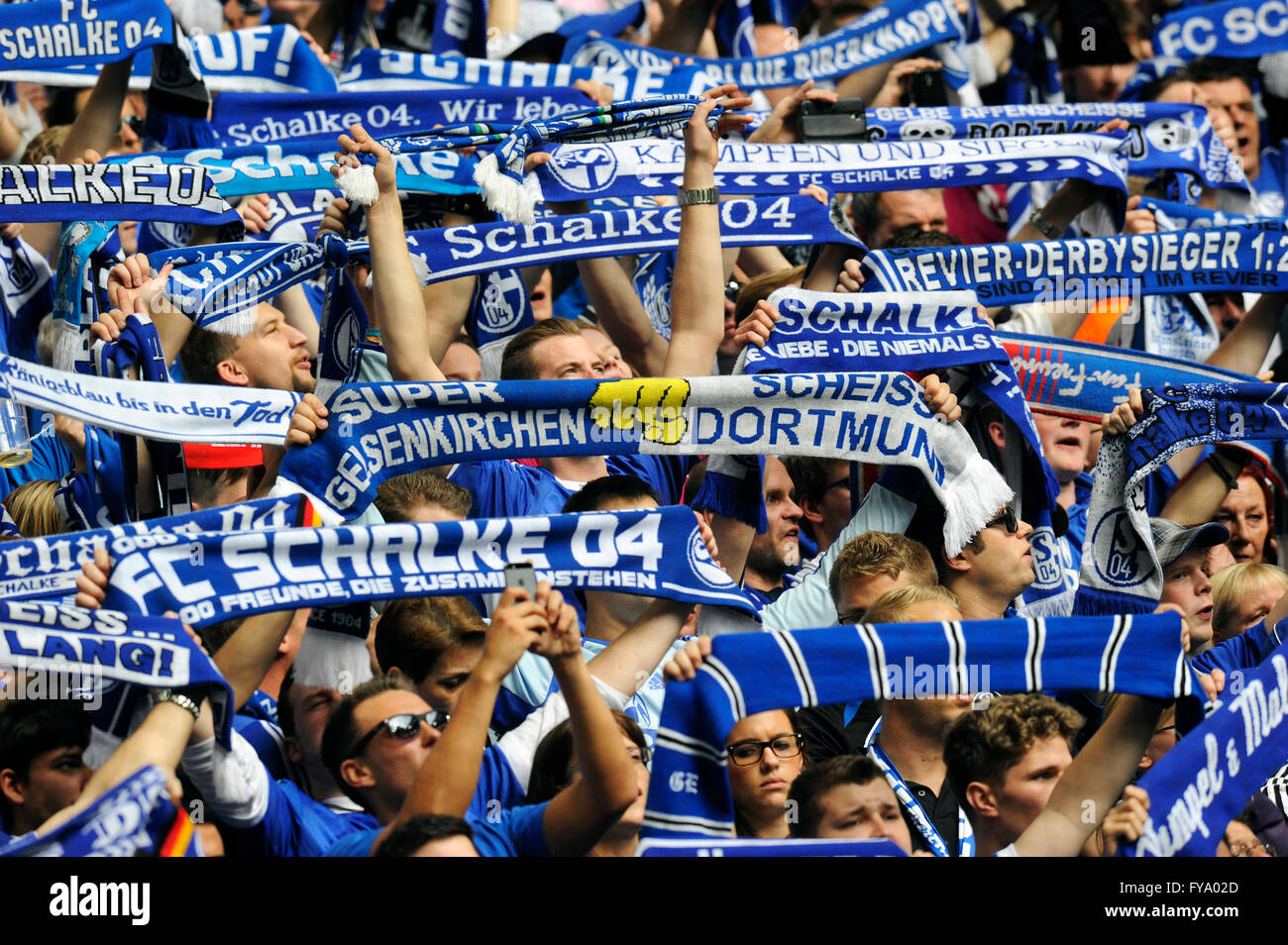 Schalke Fans On The North Stand Holding Up Scarves Fc Schalke 04 Stock Photo Alamy