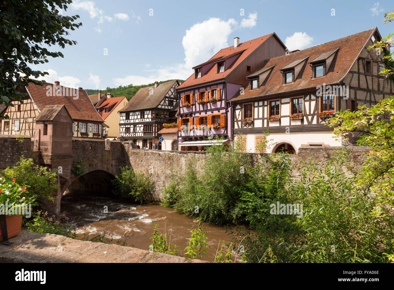 Half-timbered houses on the river Weiss, Kaysersberg, Alsace, France - Stock Image