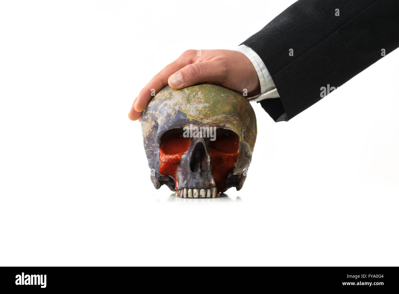 bloody Earth under pressure of a Businessman - Stock Image