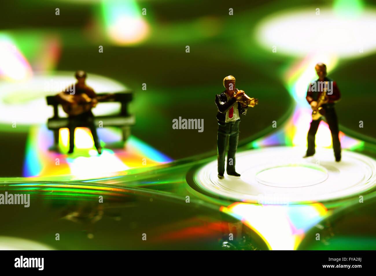 Miniature musicians compact disc - Stock Image