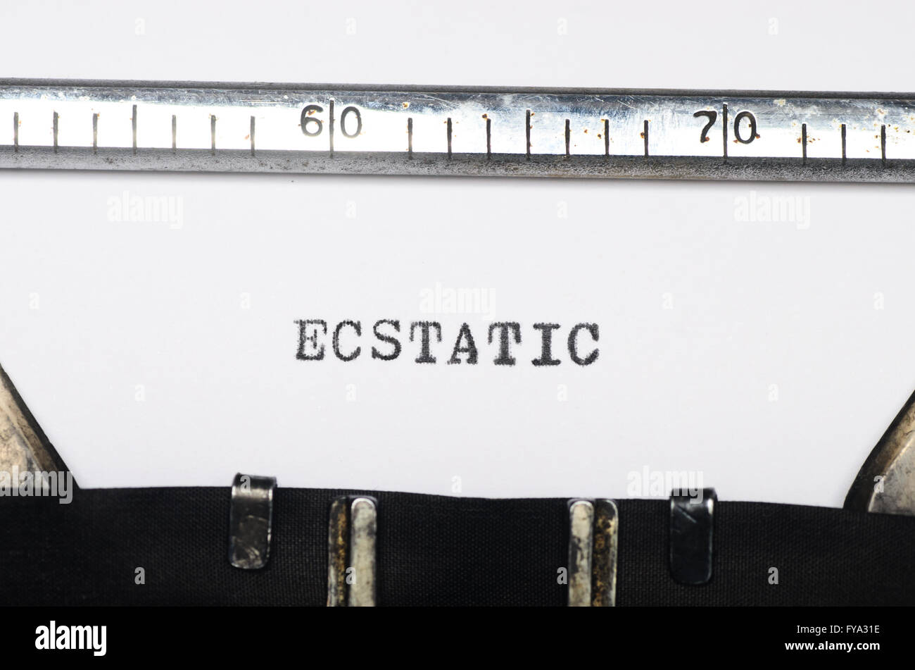 Word ecstatic typed on an old typewriter - Stock Image