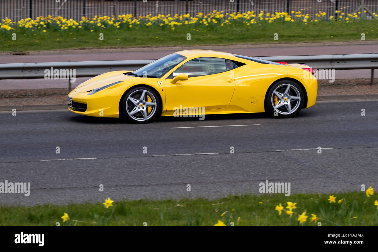 A Ferrari 458 Italia Yellow Travelling Along The Kingsway Dual Stock Photo Alamy