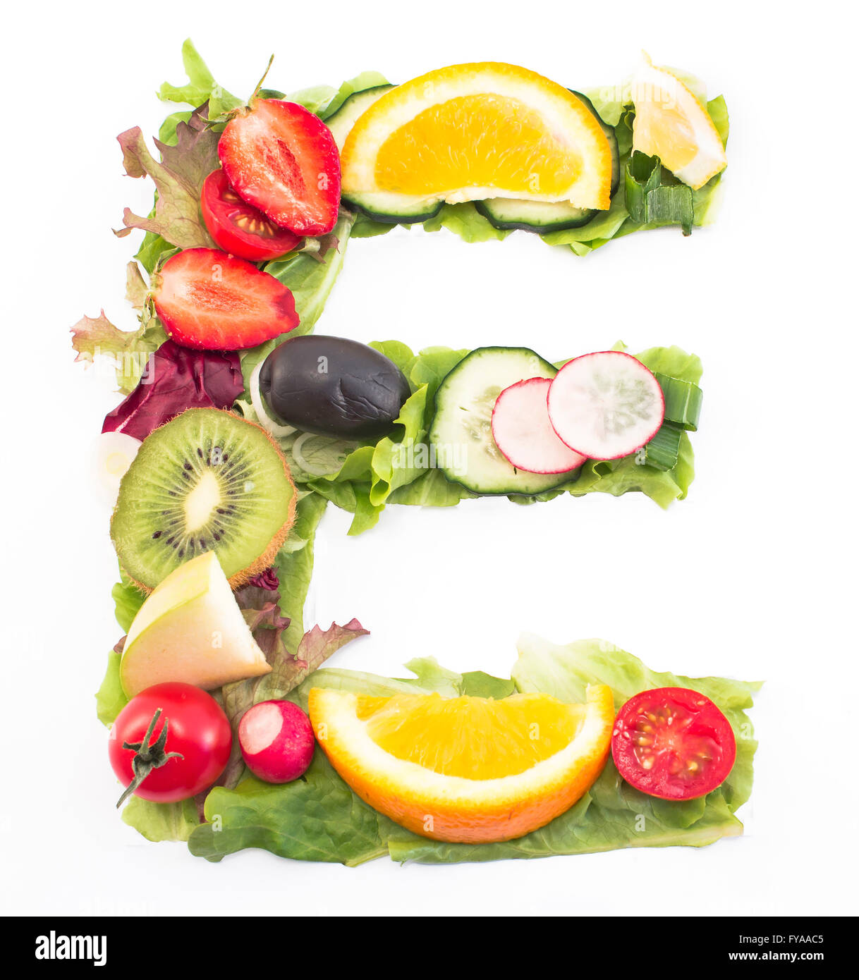 Letter E Made Of Salad And Fruits Stock Photo: 102875253