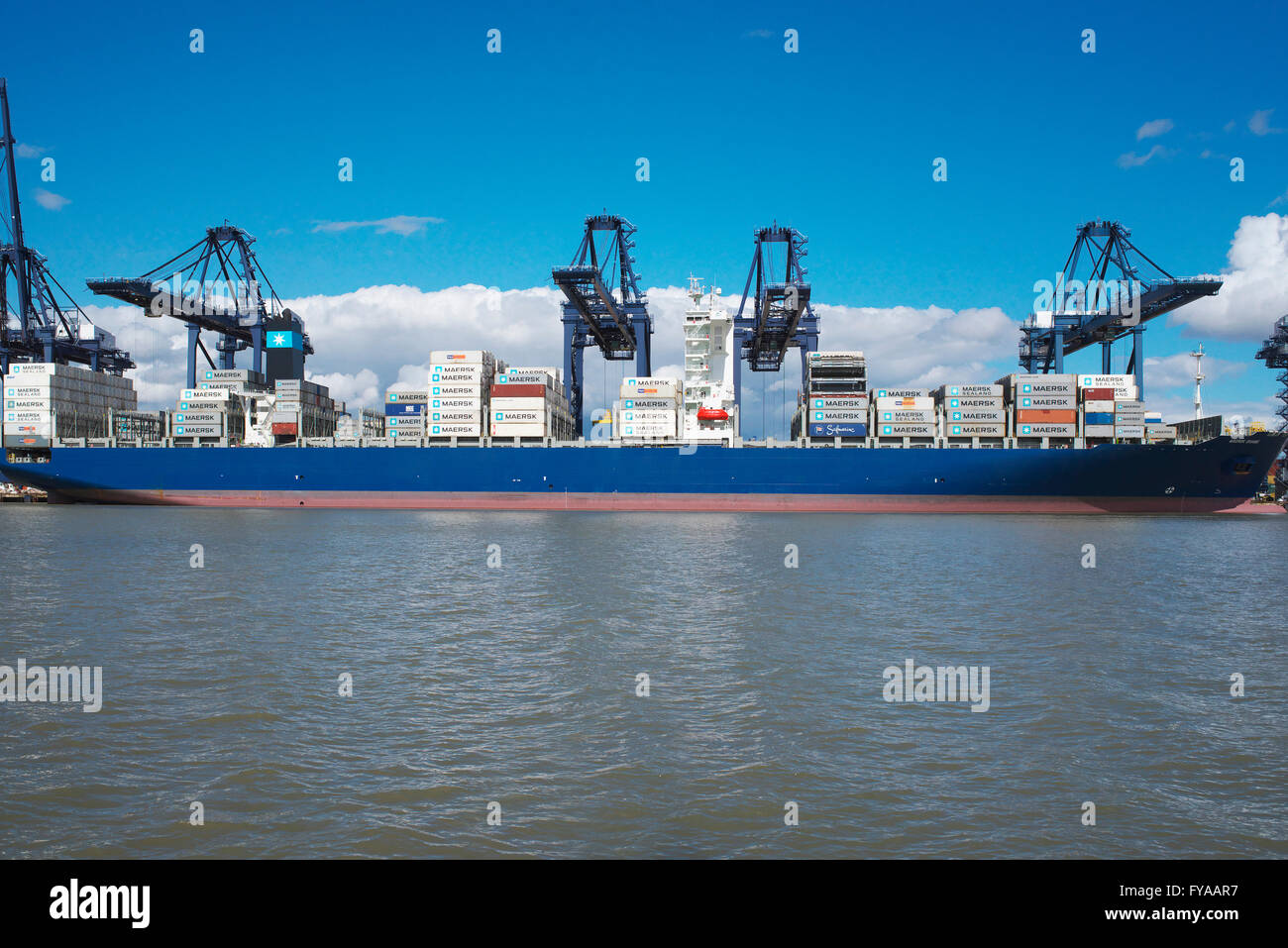 View from the North Sea of the Port of Felixstowe in Suffolk and a container ship being loaded from the shore - Stock Image