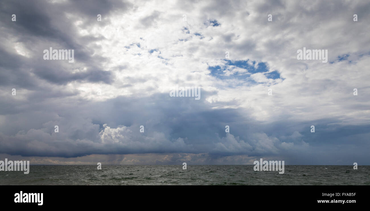 Dark clouds above the Baltic Sea, Mecklenburg-Western Pomerania, Germany - Stock Image