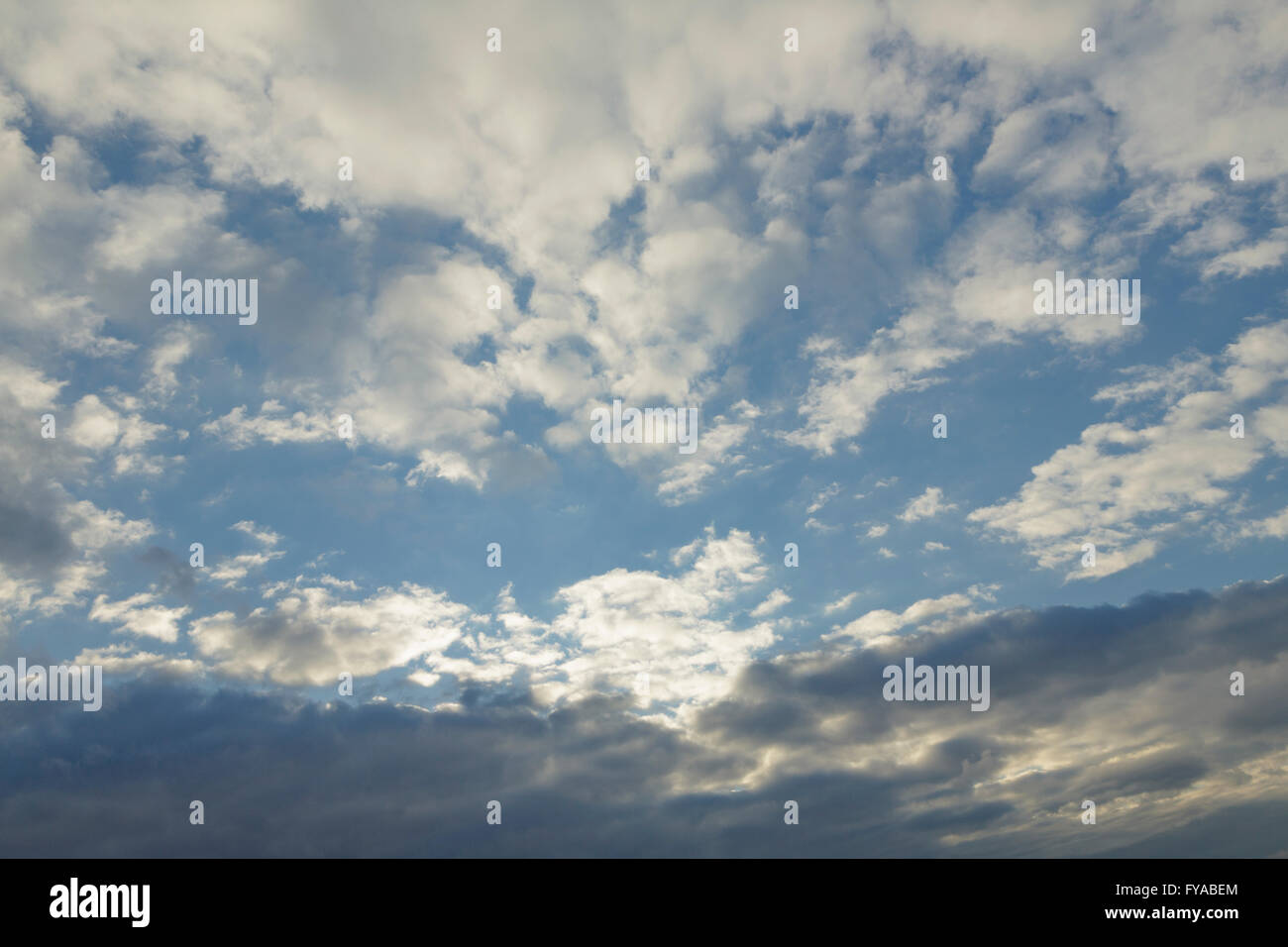 Stratocumulus and Altocumulus clouds Stock Photo