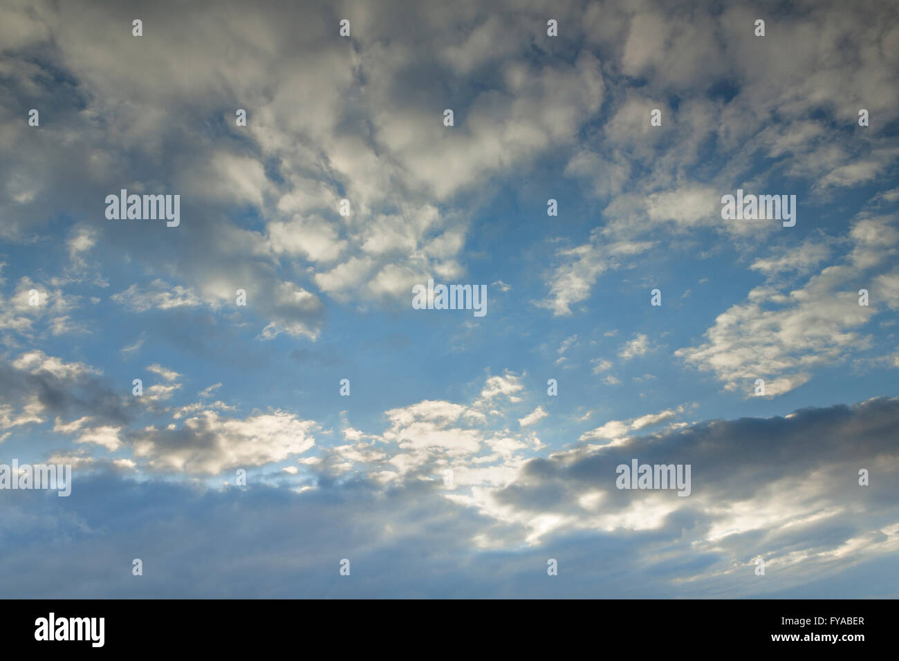 Stratocumulus and Altocumulus clouds Stock Photo