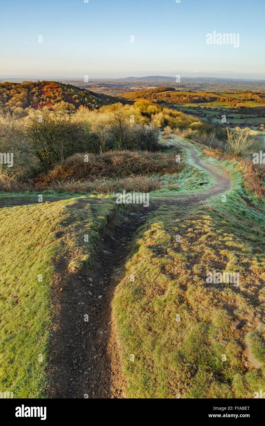 An eroded path on Midsummer Hill on the Malverns is emphasized by the sunrise on a Winters morning. Stock Photo
