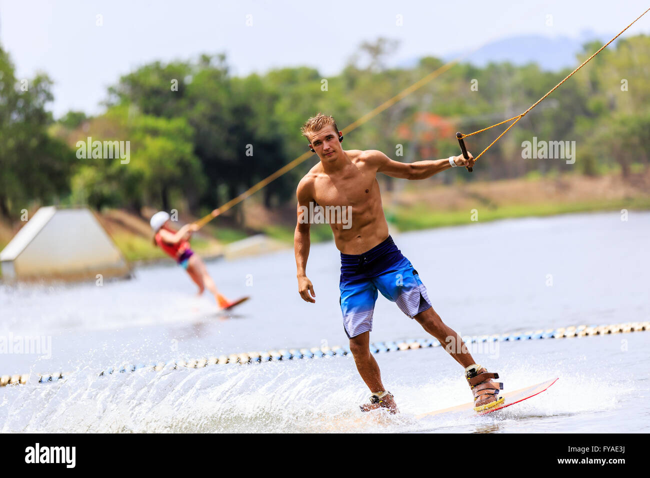 Man Wakeboarding in action. Phuket, Thailand - Stock Image