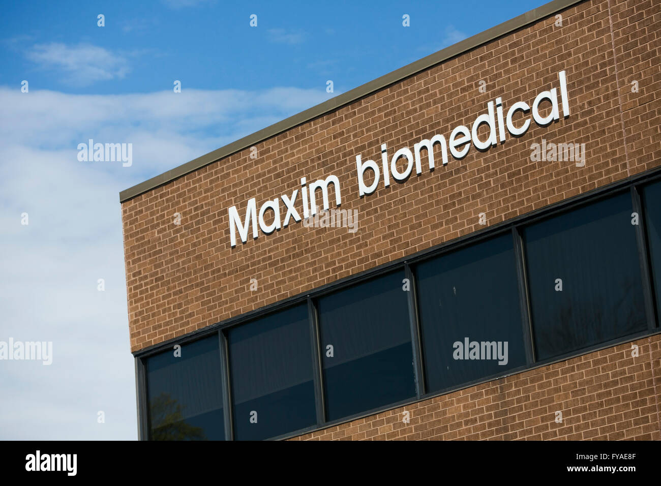 A logo sign outside of the headquarters of Maxim Biomedical, Inc., on April 10, 2016 in Rockville, Maryland. - Stock Image