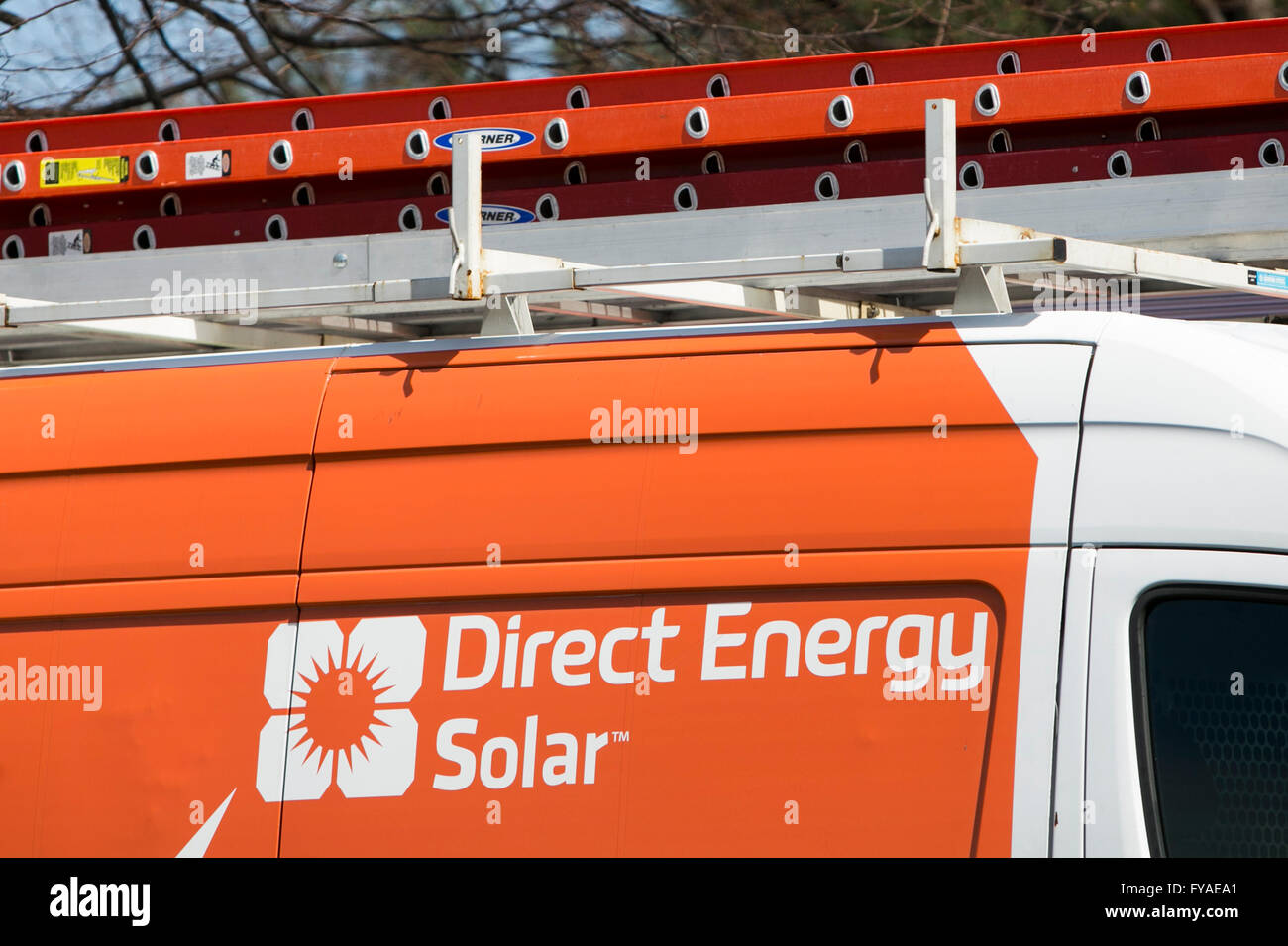 Work vans featuring Direct Energy Solar logos in Columbia, Maryland on April 10, 2016. - Stock Image