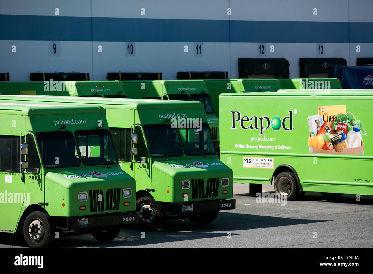 Delivery vans featuring Peapod logos outside of a distribution warehouse in Hanover, Maryland on April 10, 2016. - Stock Image