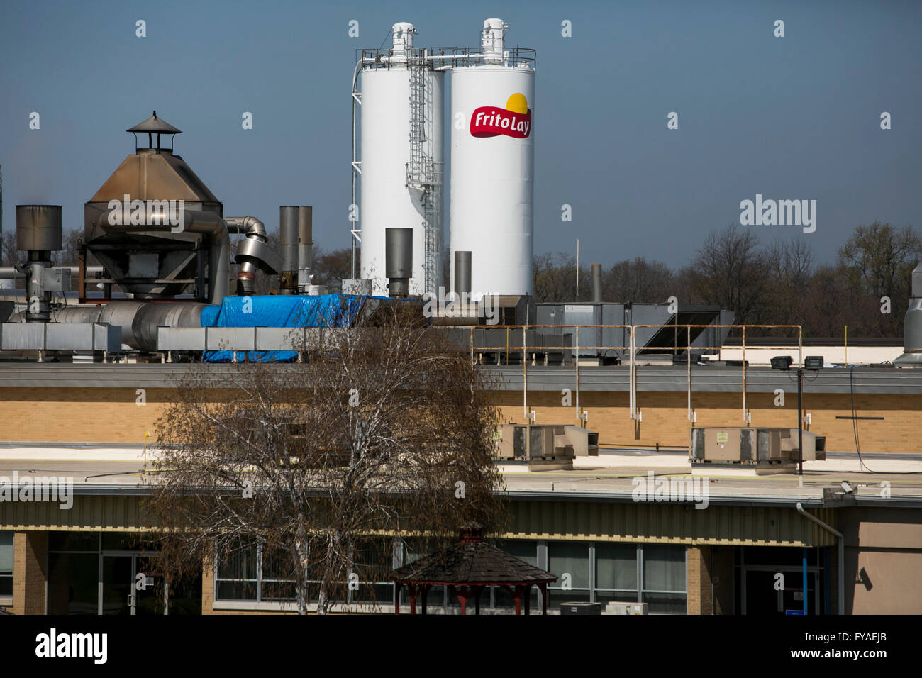 A logo sign outside of a Frito-Lay, Inc., factory in York, Pennsylvania on April 17, 2016. - Stock Image