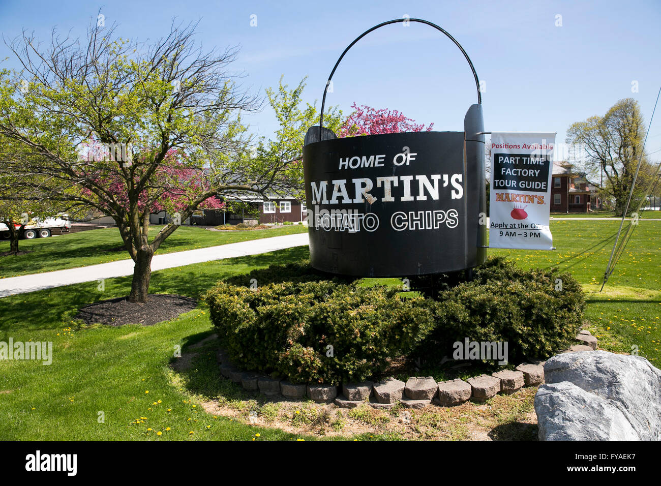 A logo sign outside of the headquarters of Martin's Potato Chips, Inc., in Thomasville, Pennsylvania on April - Stock Image