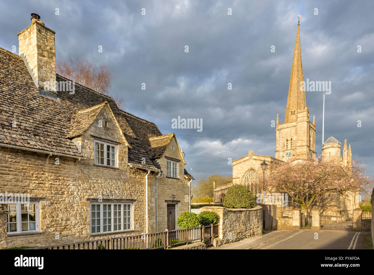 St John the Baptist church in late afternoon light, Burford the Cotswolds, Oxfordshire, England, UK - Stock Image