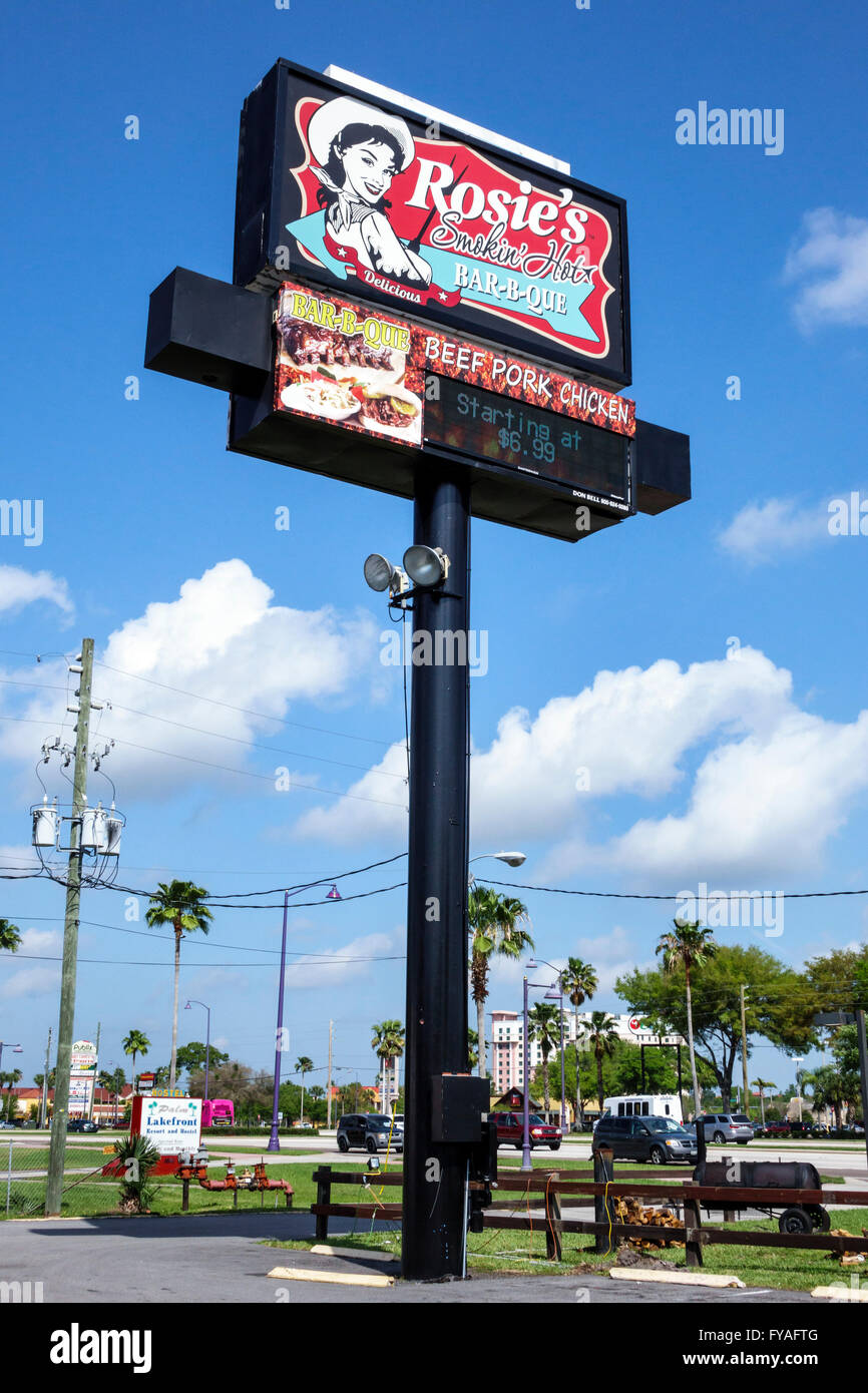Kissimmee Orlando Florida Orlando highway billboard sign pole Rosie's Smokin' Hot Bar-b-que restaurant - Stock Image