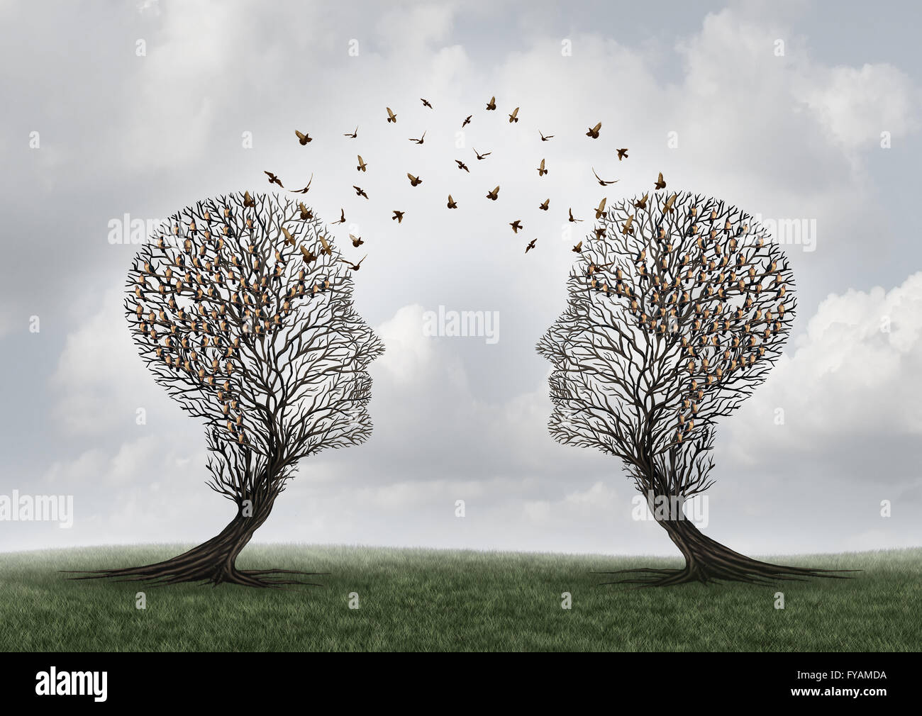 Concept of communication and communicating a message between two head shaped trees with birds perched and flying - Stock Image