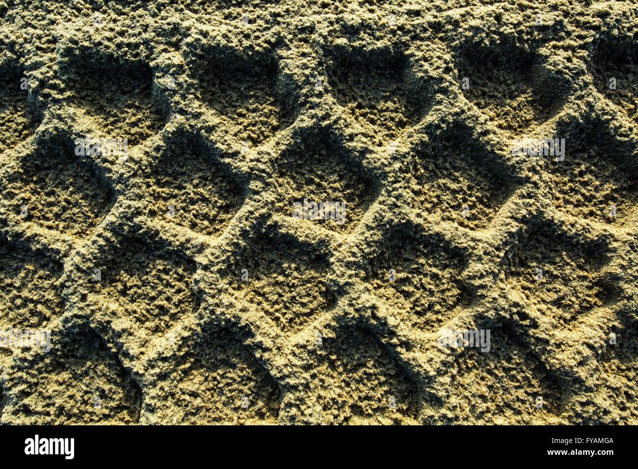 Tire Tracks on sandy ground - Stock Image