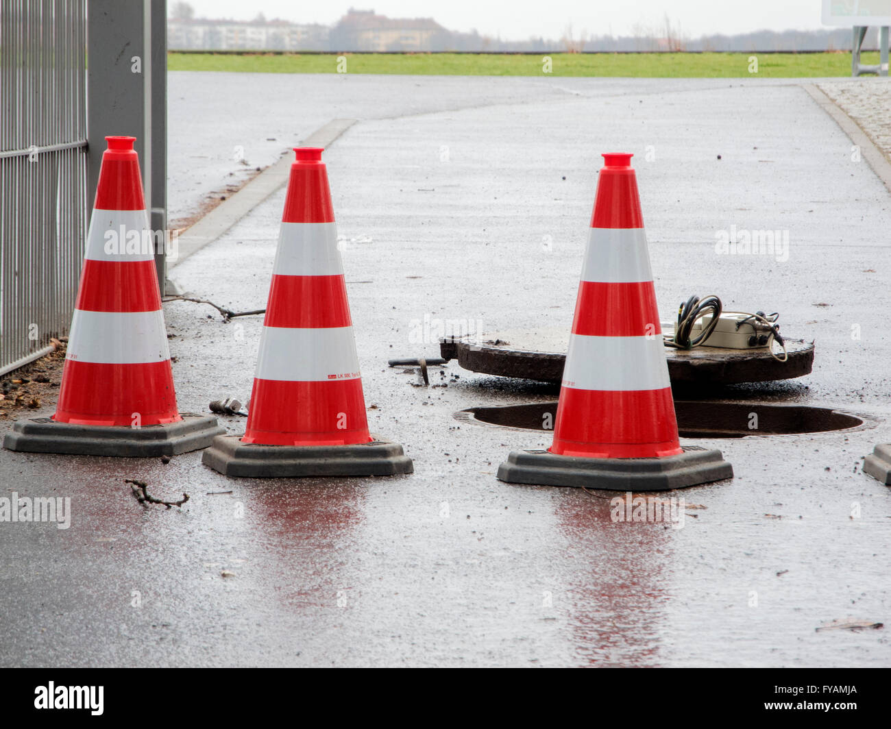 Berlin, Germany - March 30, 2016: three pylons as protection against water meter shaft on the to the airfield Tempelhof - Stock Image