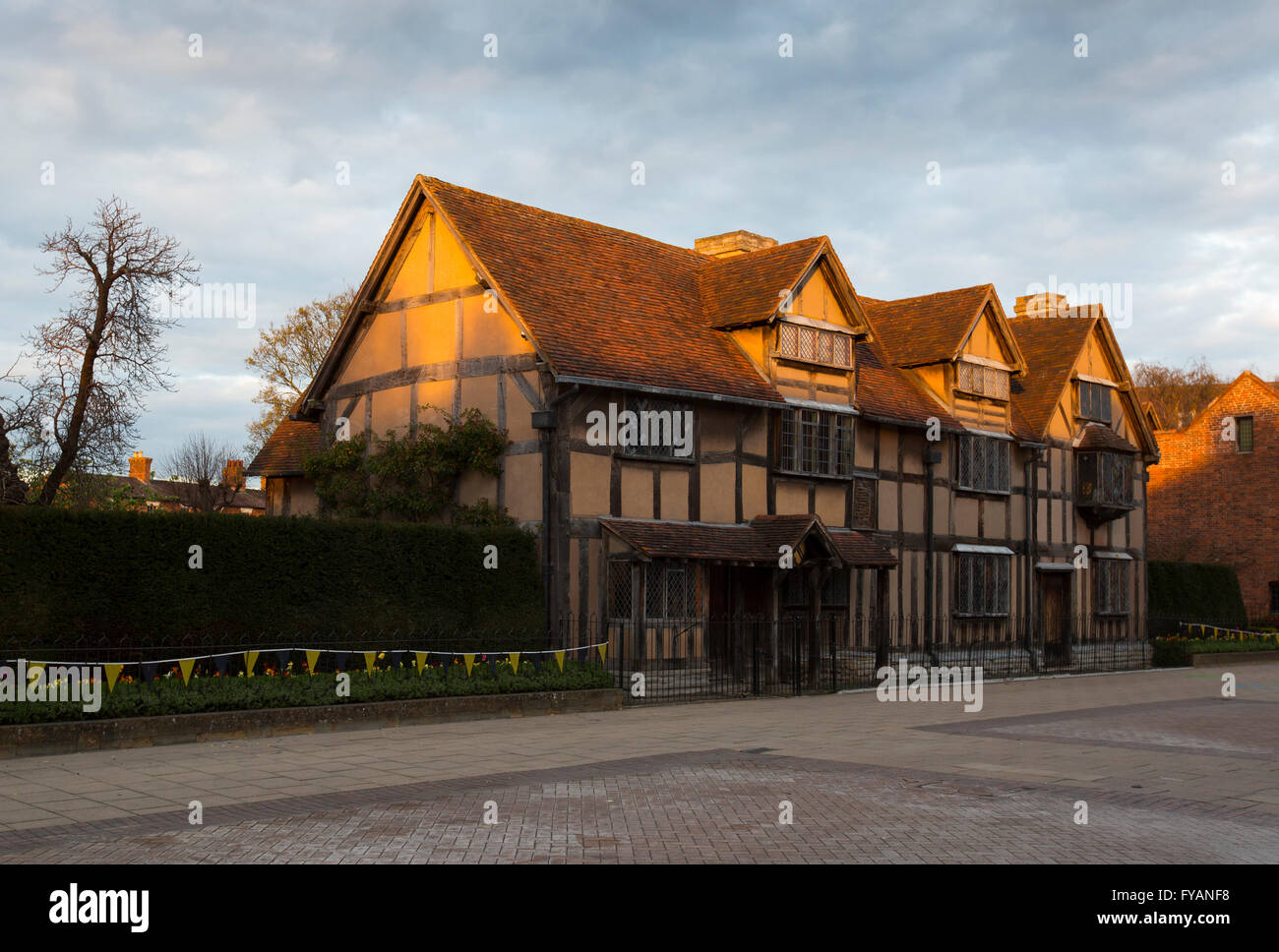 Shakespeare's birthplace caught by the setting sun in Stratford-upon-Avon, UK, on the day of the 400th anniversary - Stock Image