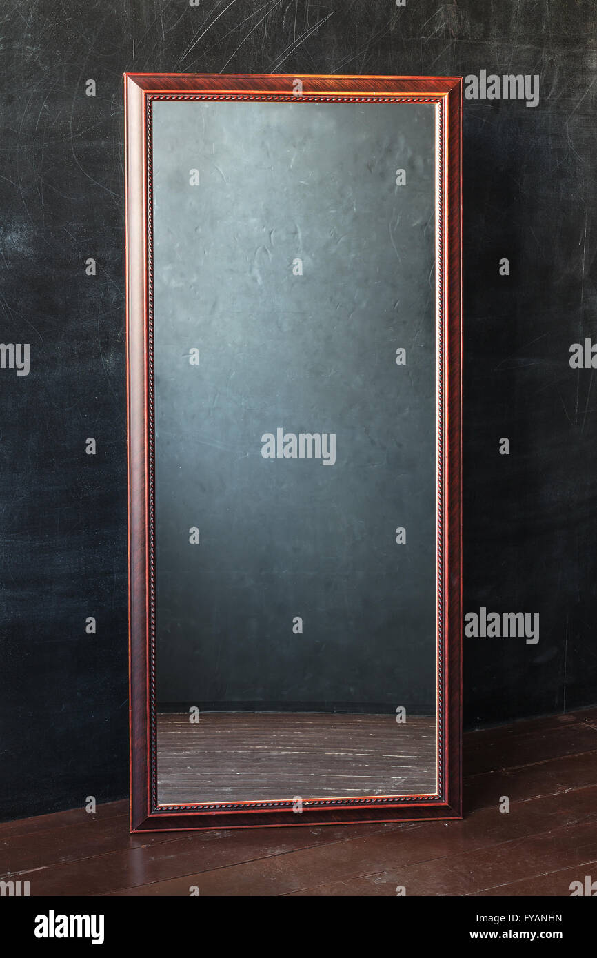Classic Rectangular Mirror Without Reflection Standing In The Empty Room With Black Wall