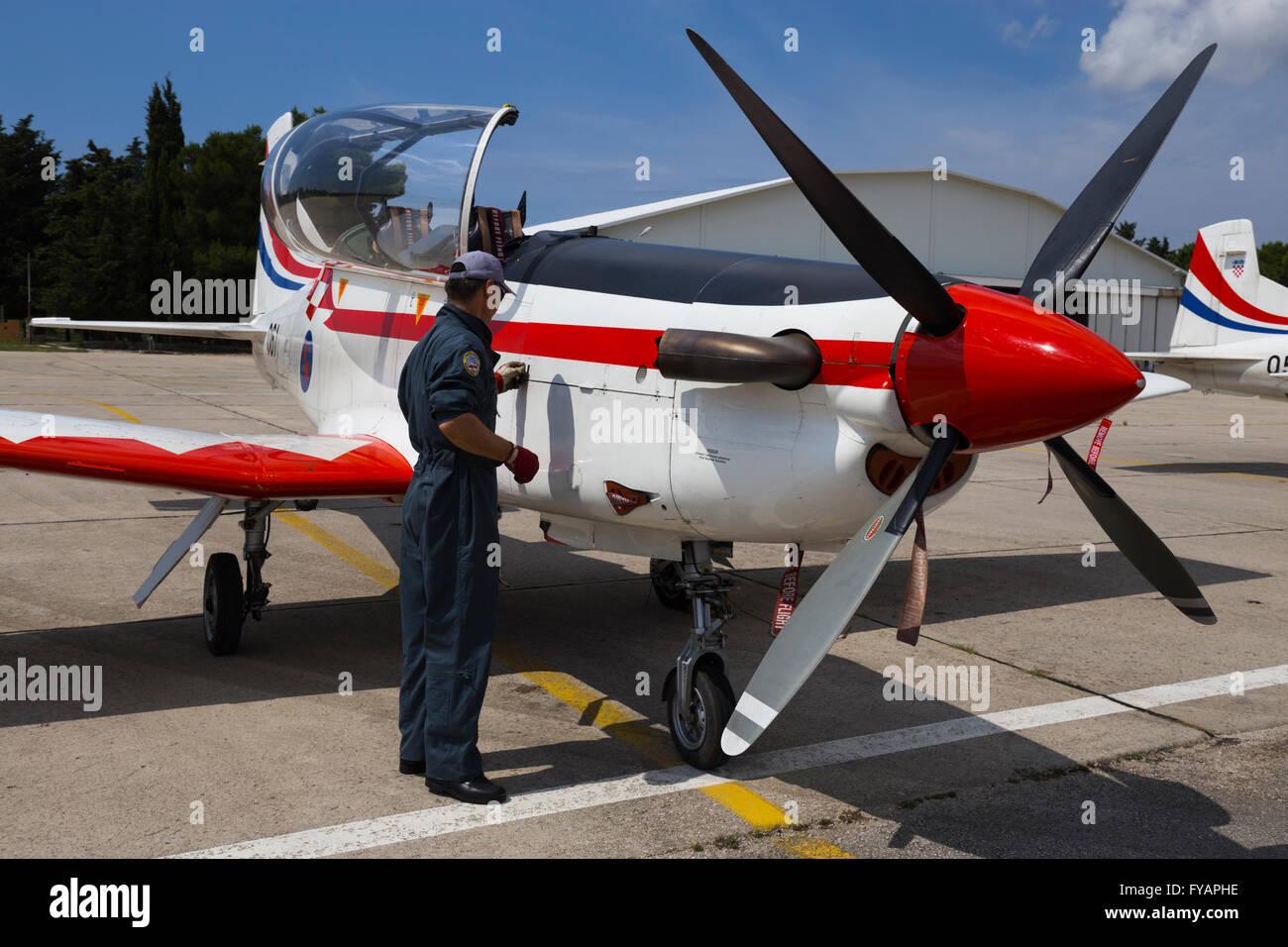 Aviation mechanic propeller training advanced Pilatus PC-9 Red propeller-driven turboprop Stock Photo