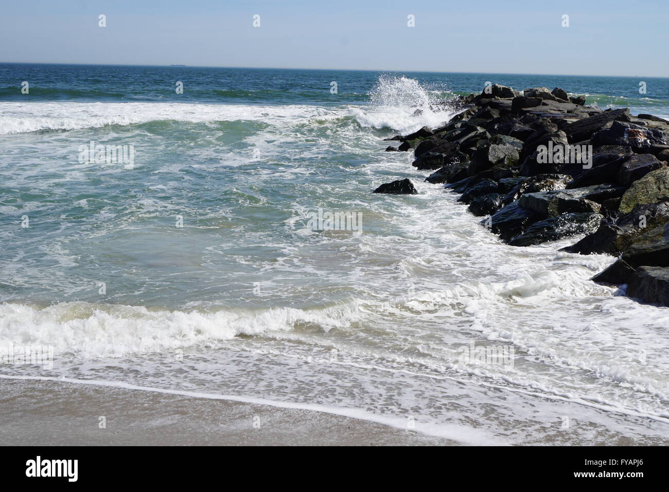 Ocean waves hitting a jetty. Stock Photo