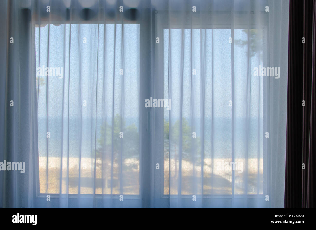 View out of the window towards the beach in Binz on Ruegen - Stock Image