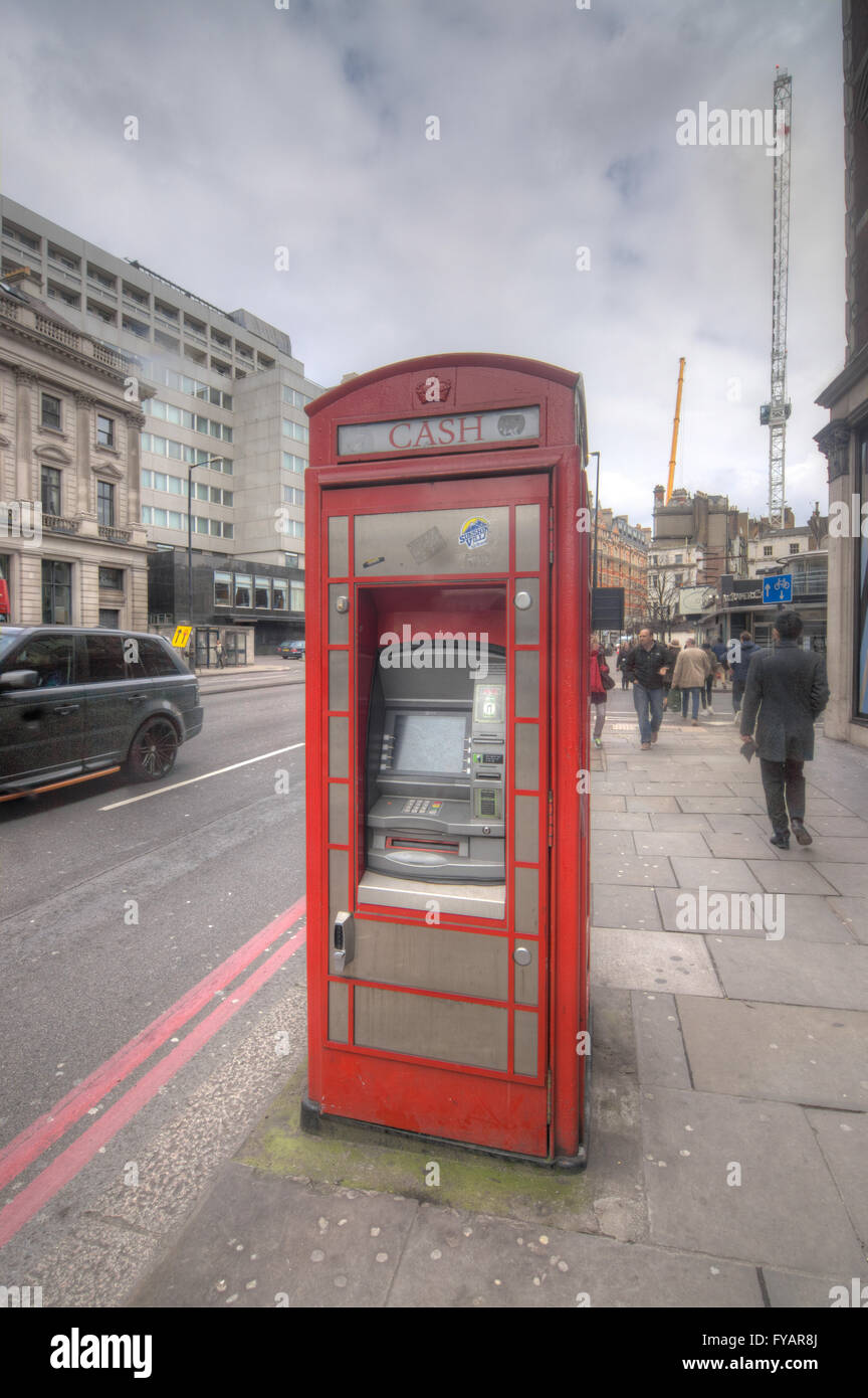 ATM phone box  converted phone box London - Stock Image