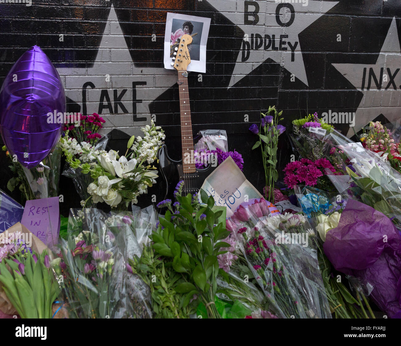 Memorials left against the wall of the First Avenue nightclub in memory of music legend Prince - Stock Image