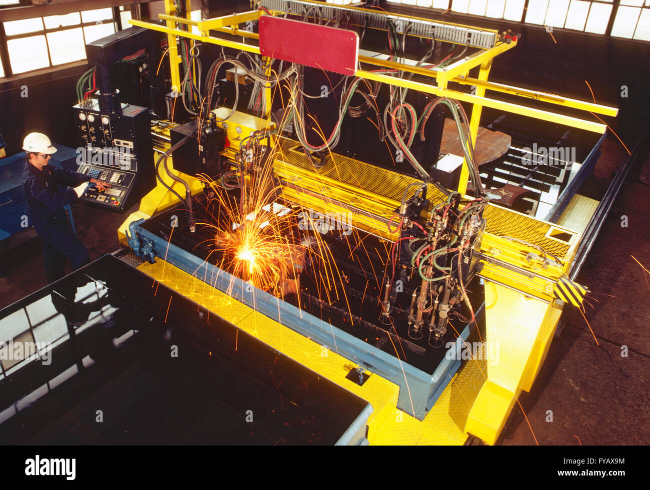 Sophisticated CAD - CAM machine automatically cutting steel - Stock Image