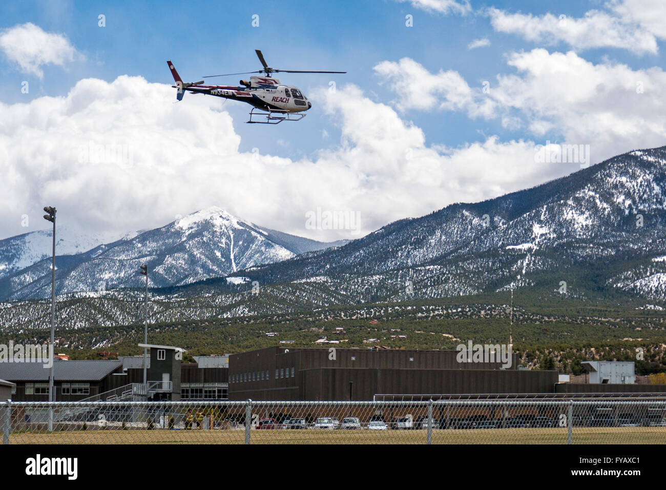 'Reach' Flight for Life medical helicopter landing on high school field - Stock Image