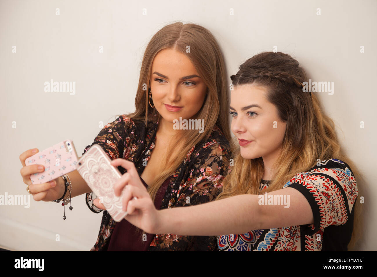 Two teenage girls taking a selfie of themselves. - Stock Image