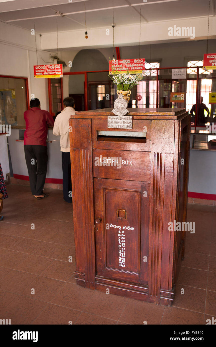 Sri Lanka, Nuwara Eliya, Post Office interior, wooden letter posting box and counters - Stock Image