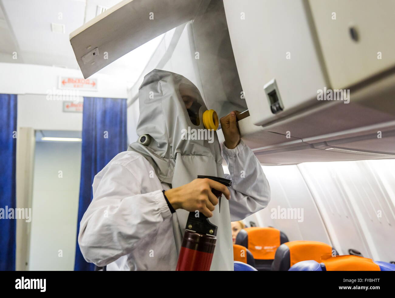 Moscow, Russia. 25th Apr, 2016. A flight attendant-to-be battling a fire on board a plane during a training session - Stock Image