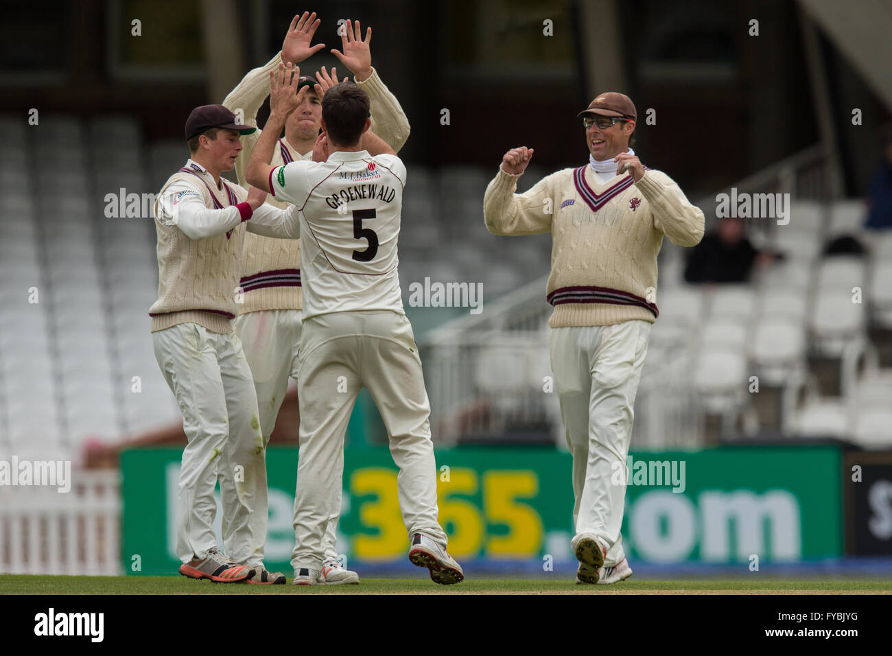 London, UK. 25 April 2016. Somerset players congratulate Tim Groenewald after he gets the wicket of Ben Foakes, - Stock Image