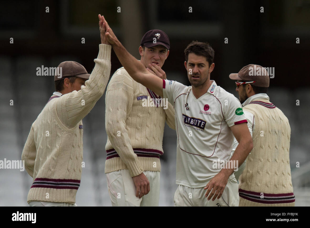 London, UK. 25 April 2016. Tim Groenewald gets a high-five from a team mate, after taking the wicket of Ben Foakes, - Stock Image