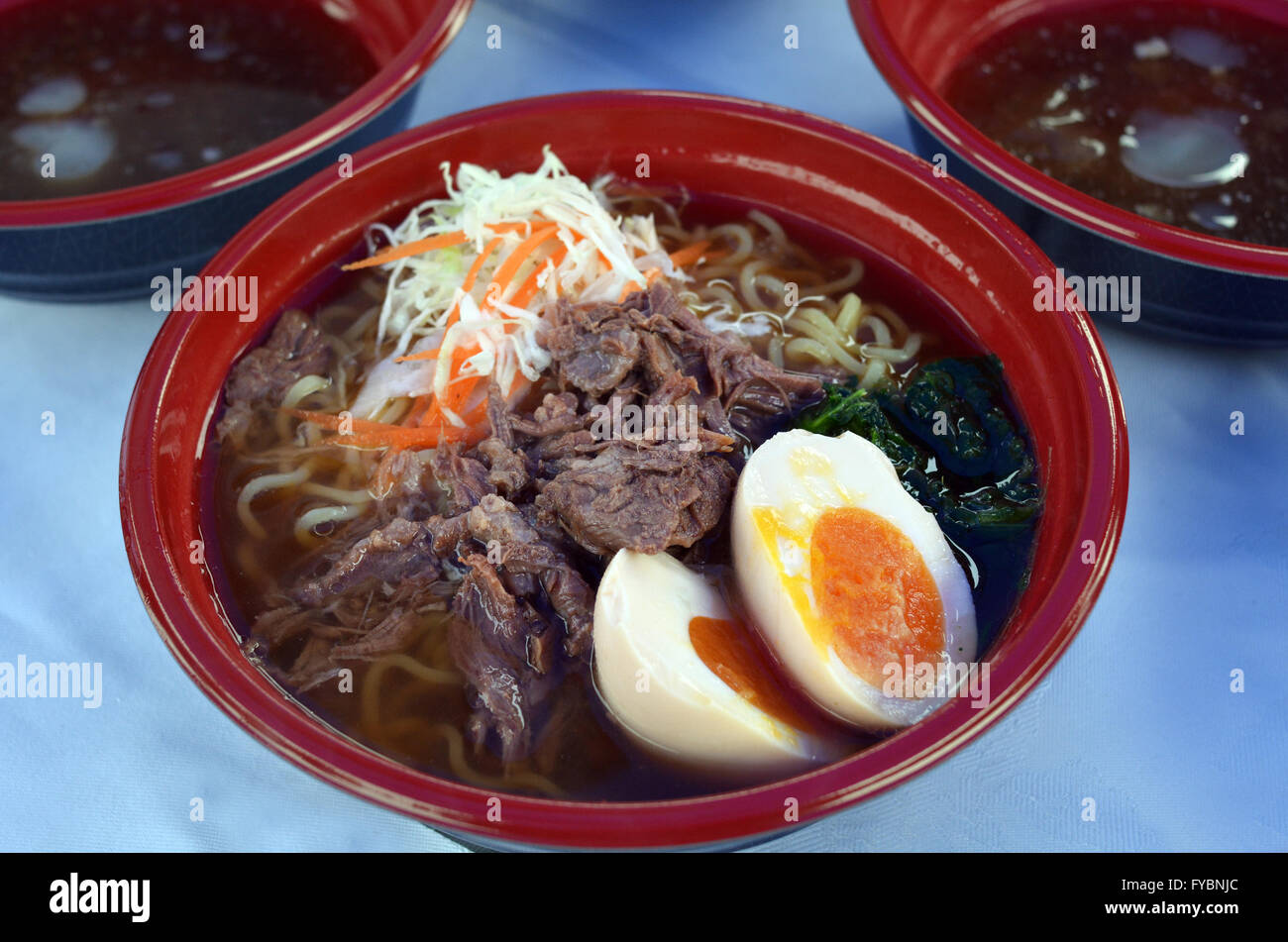 Japanese noodle soup dish Ramen served on restaurant table. - Stock Image