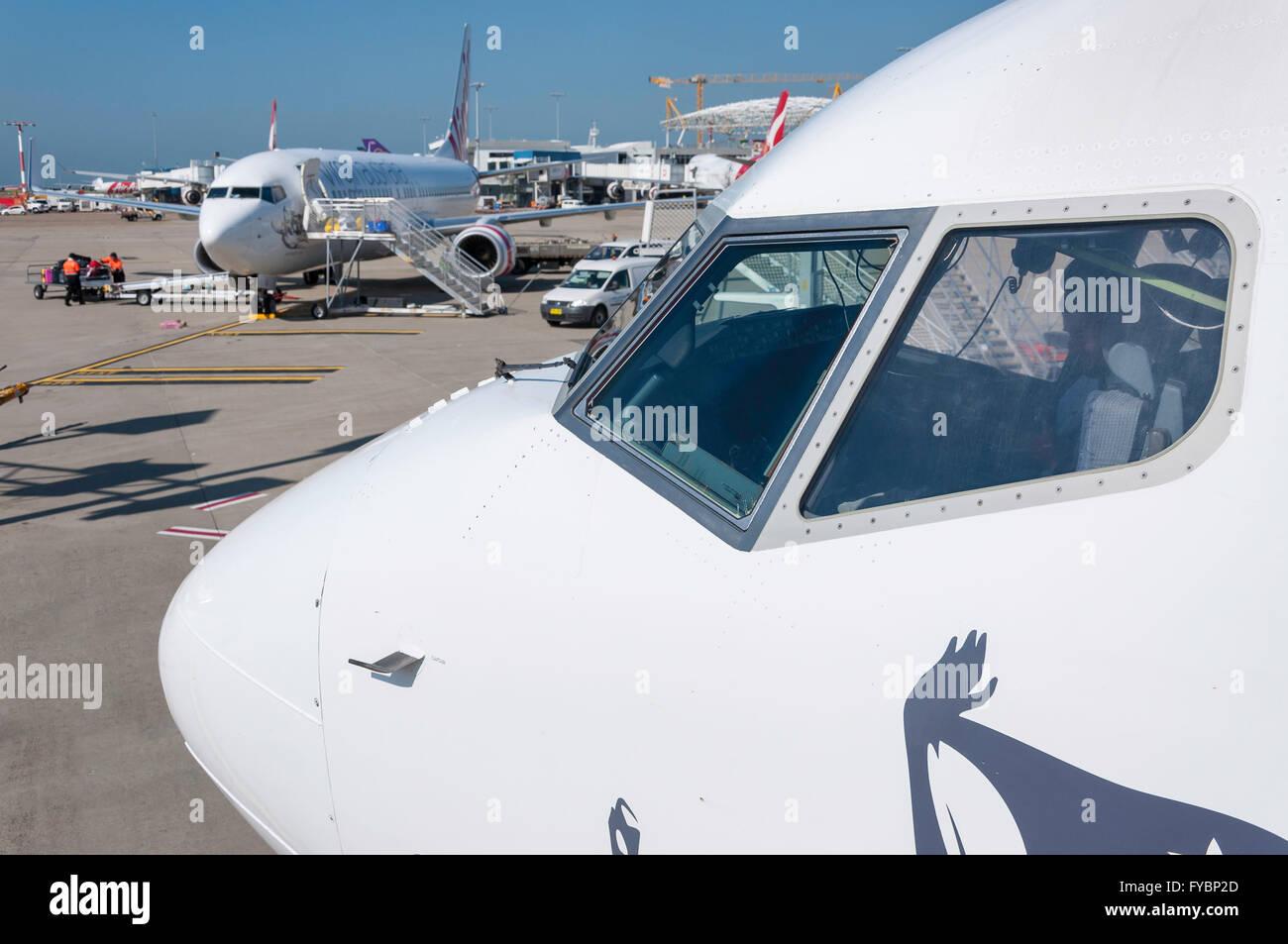 Aircraft on tarmac at Sydney Kingsford Smith Airport, Mascot, Sydney, New South Wales, Australia - Stock Image
