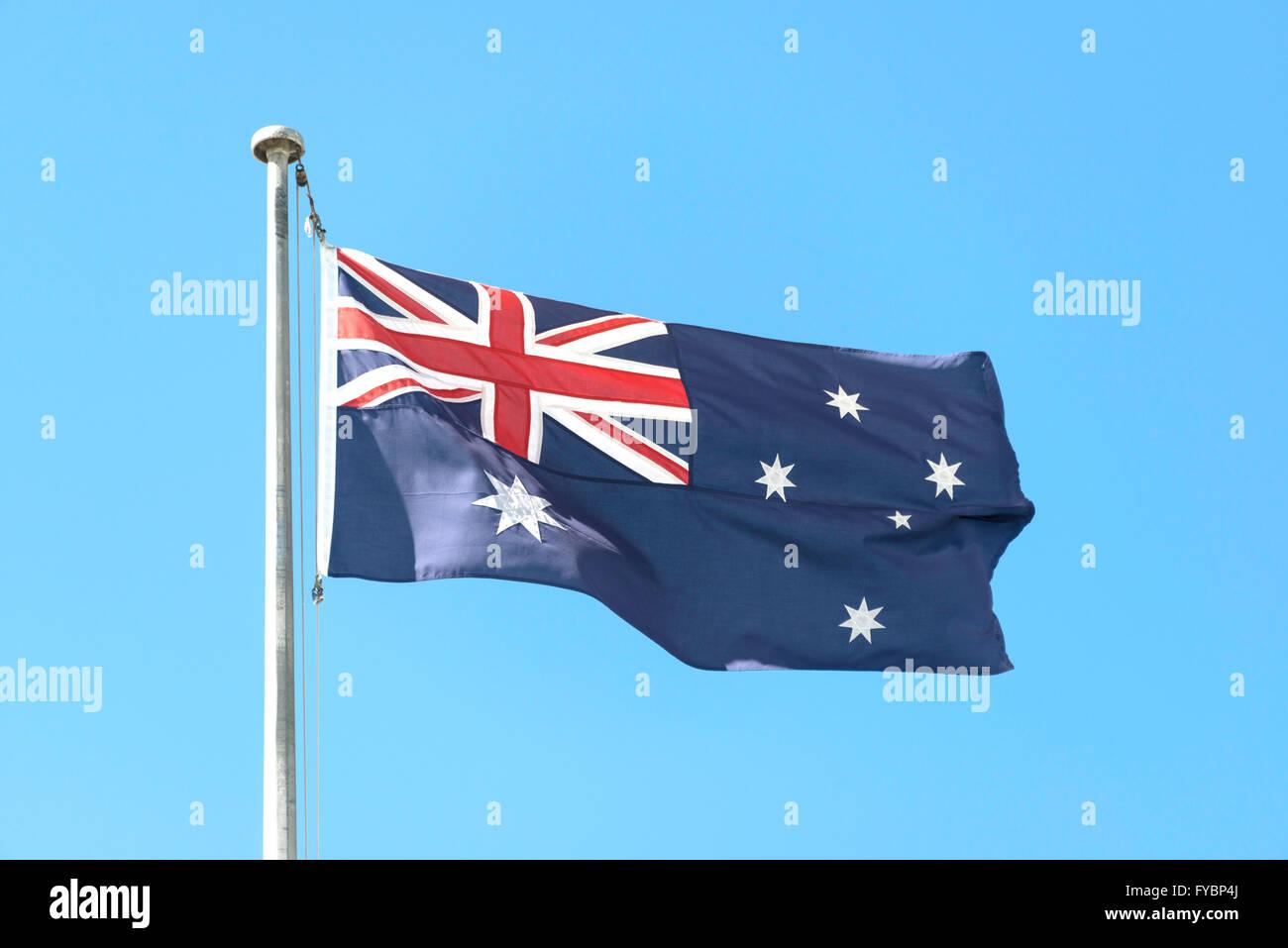 Australian flag flying on flagpole, Sydney Kingsford Smith Airport, Mascot, Sydney, New South Wales, Australia - Stock Image