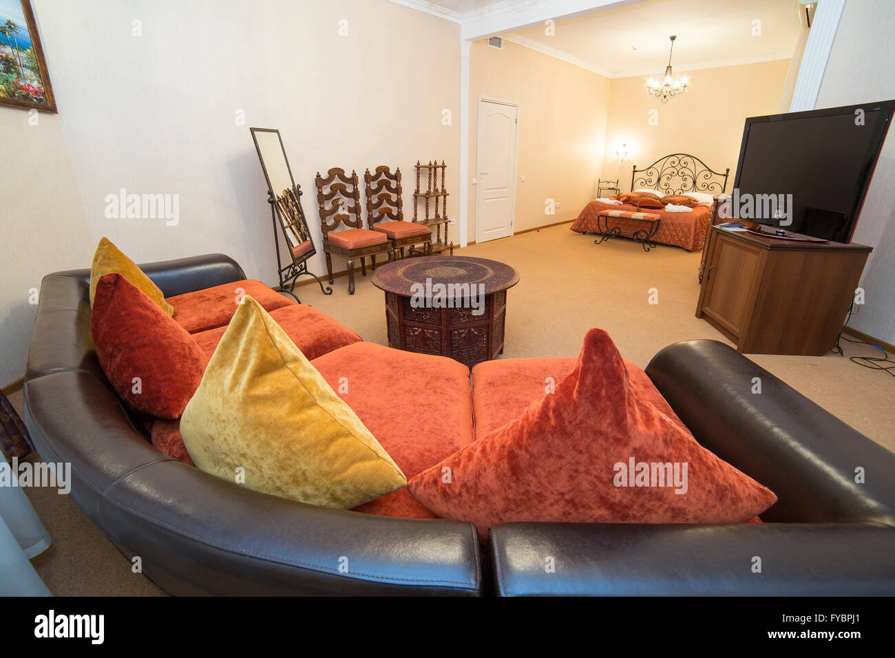 Apartment Interior In Turkish Style With Sofa, Pillows And Wooden Art  Carved Small Table