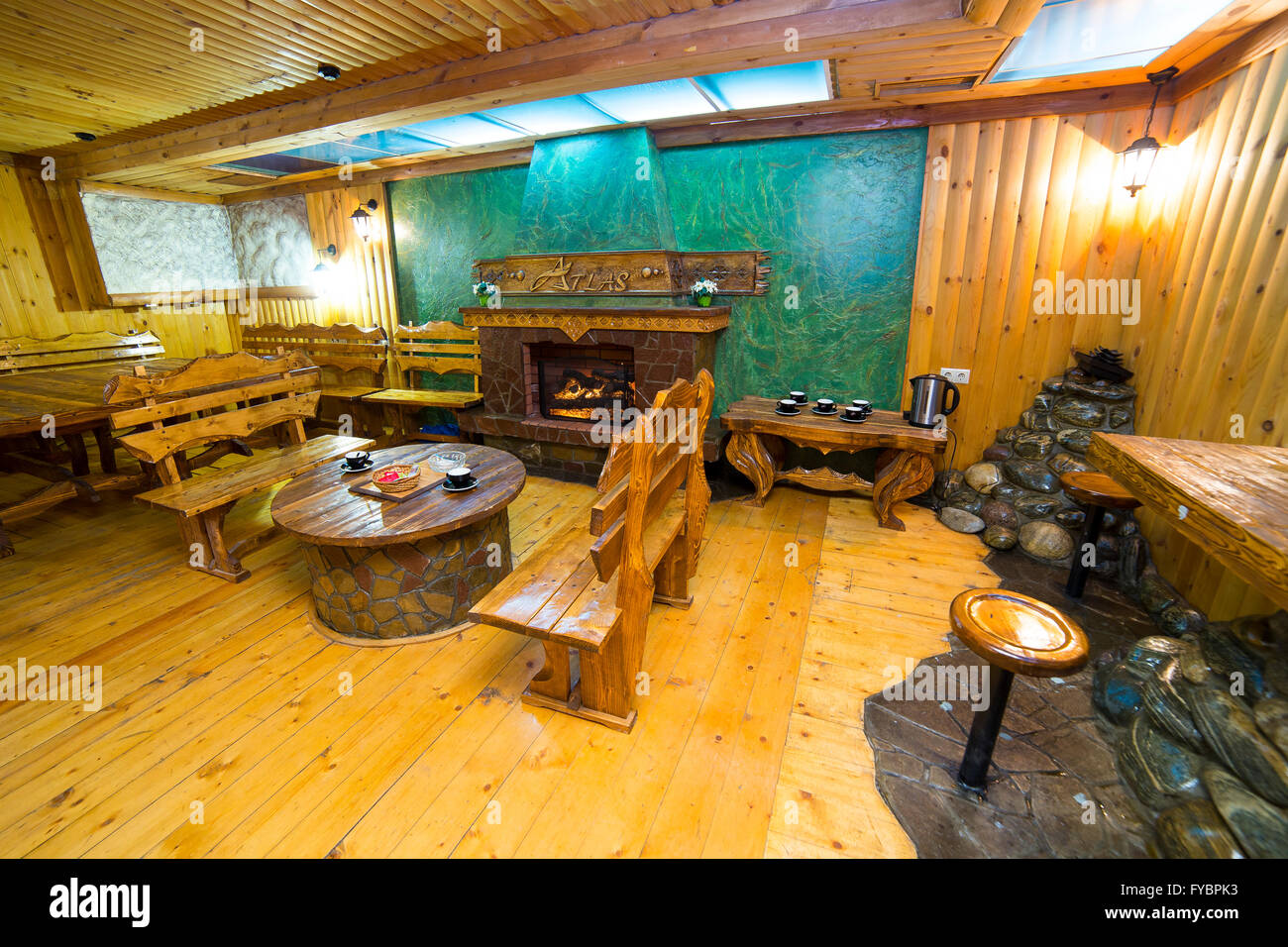 Interior of a restaurant designed in wood with bar - Stock Image