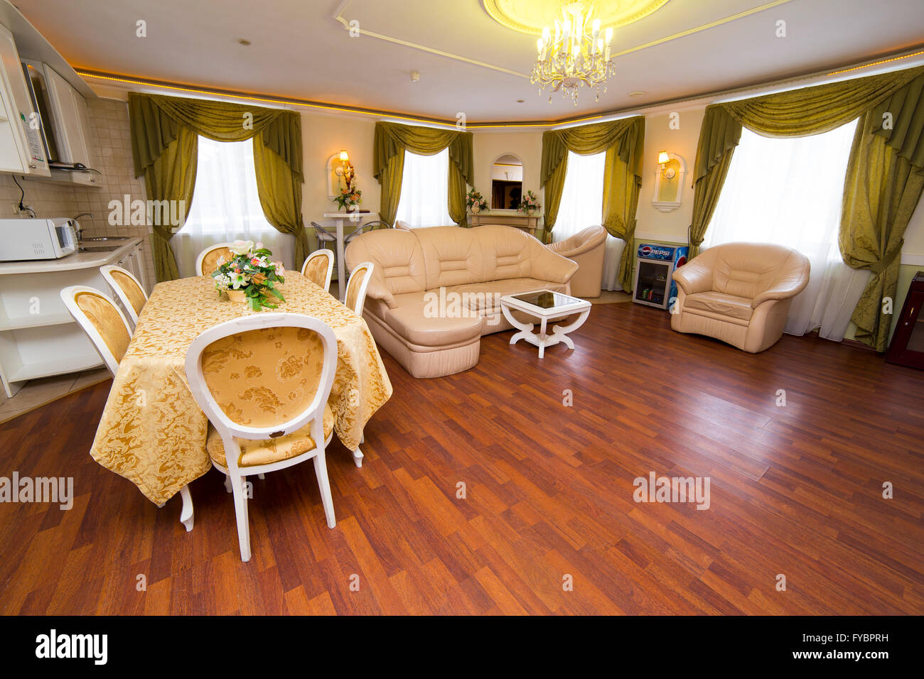 Apartment classic style interior with dinner table and sofa - Stock Image